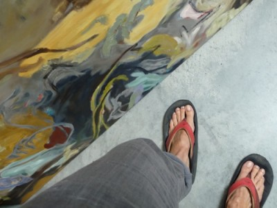 painting and feet of barbra edwards, Canadian abstract artist on Pender Island, BC